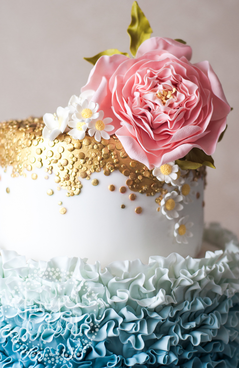 Ruffles and daisies wedding cake by Juniper Cakery