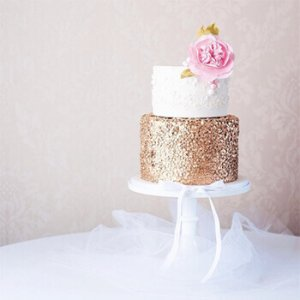 Gold sequin and white lace wedding cake by Juniper Cakery
