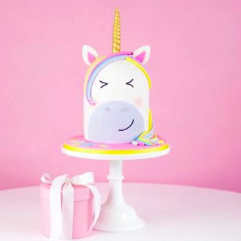 Cute rainbow unicorn shaped cake by Juniper Cakery