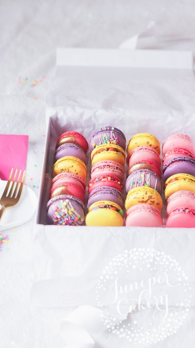 Colourful unicorn macarons by Juniper Cakery