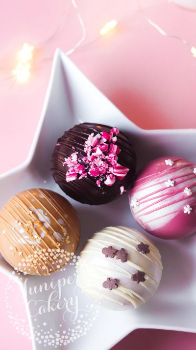 Mix of festive hot chocolate bombes by Juniper Cakery