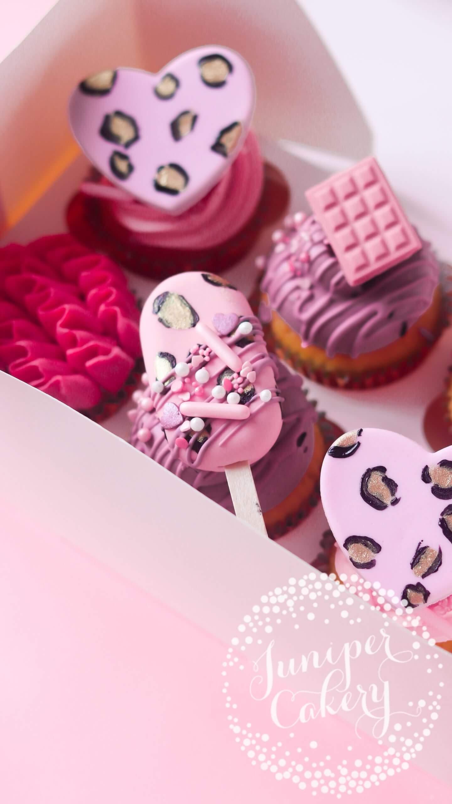 Cute leopard print cupcakes by Juniper Cakery